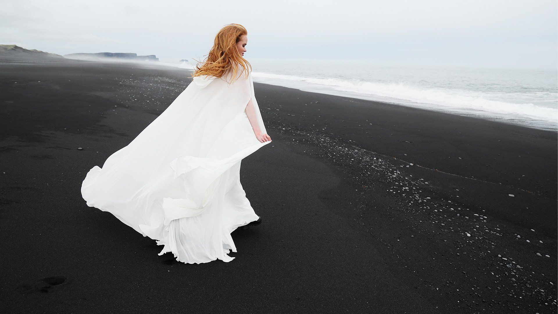 Female in wedding dress on Iceland beach shot using Canon EOS R and RF 24-105mm F4L IS USM
